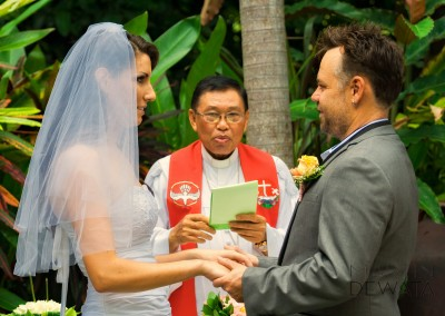 the priest with the couple